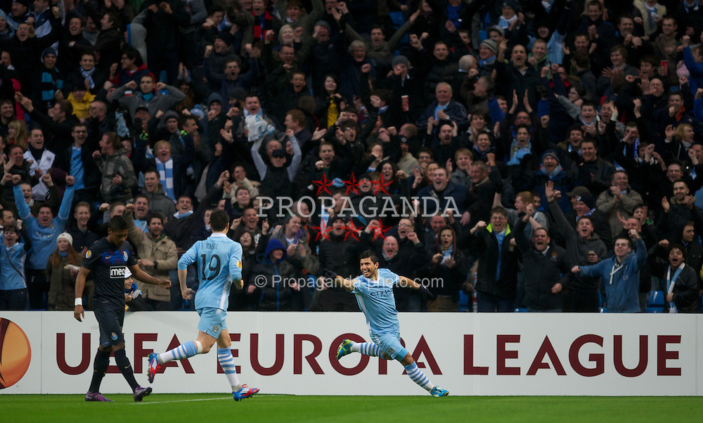 MANCHESTER, ENGLAND - Wednesday, February 22, 2012: Manchester City's Sergio Aguero celebrates scoring the first goal against FC Porto during the UEFA Europa League Round of 32 2nd Leg match at City of Manchester Stadium. (Pic by David Rawcliffe/Propaganda)
