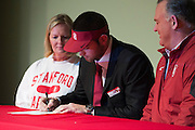 Flower Mound Marcus High School senior tight end Kaden Smith signs his National Letter of Intent to play football at Stanford University during his high school signing day on February 3, 2016. (Cooper Neill for The New York Times)
