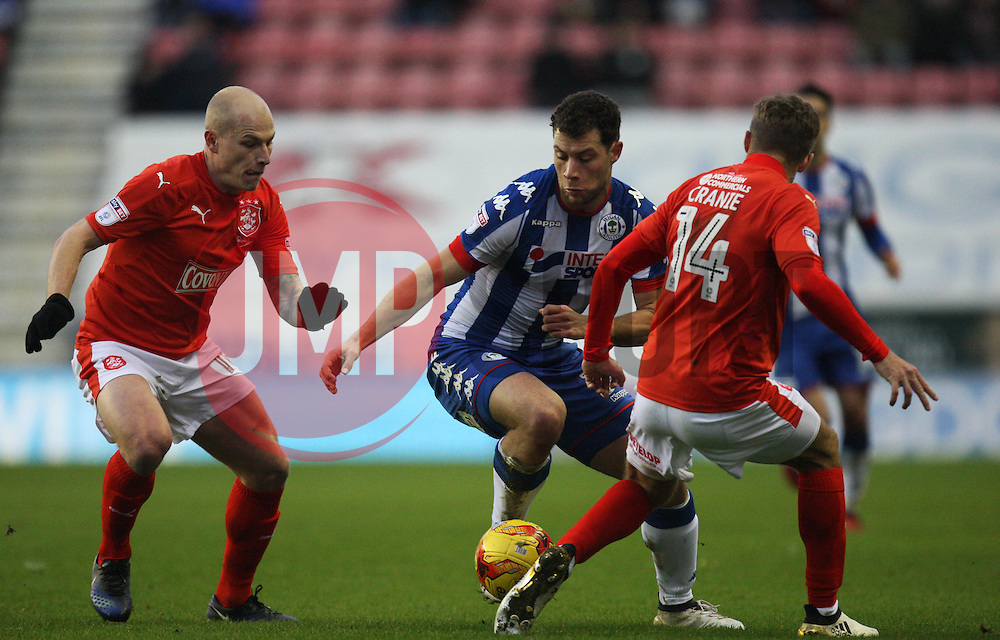 Aaron Mooy (L) and Martin Cranie of Huddersfield Town (R) in action against Yanic Wildschut of Wigan Athletic - Mandatory by-line: Jack Phillips/JMP - 02/01/2017 - FOOTBALL - DW Stadium - Wigan, England - Wigan Athletic v Huddersfield Town - Football League Championship