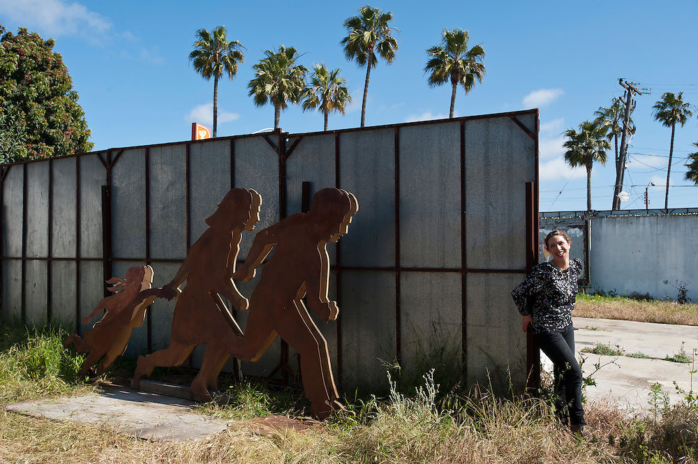 Jean Von Borstel, artist in Playas Tiuana, with an iron and wood sculpture in Playas Tijuana, Mexico...© Stefan Falke.http://www.stefanfalke.com/..