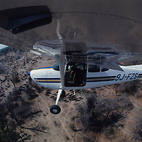 Mark Owens conducts an aerial wildwilfe survey in North Luangwa Ntional Park in Zambia. 9/90,