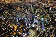Aerial view of midtown Manhattan taken from a helicopter at night by photographer Evan Joseph.