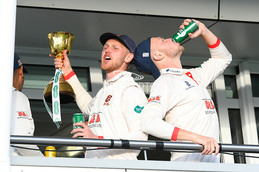 Jamie Porter of Essex and Sam Cook of Essex celebrate on the team balcony during the County Championship title celebrations during the Specsavers County Champ Div 1 match between Somerset County Cricket Club and Essex County Cricket Club at the Cooper Associates County Ground, Taunton, United Kingdom on 26 September 2019.
