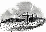 Swindon station on the Great Western Railway, 1845.   Sambaed Kingdom Brunel (1806-1859) favoured broad gauge 7ft 1/4inch (2.2m) and designed the Great Western Railway accordingly. However, in the Gauge Act of 1846 declared that all future railway track should be of the standard 4ft 8 1/2inch (1.44m) gauge introduced by George Stephenson (1781-1848) on the Liverpool & Manchester Railway.  It was not until 1892 that the last broad gauge track was lifted.  From 'The Illustrated London News'. (London, 18 October 1845).