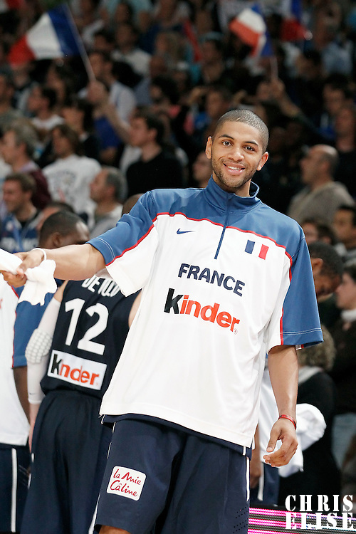 15 July 2012: Nicolas Batum of Team France waives a towel during a pre-Olympic exhibition game won 75-70 by Spain over France, at the Palais Omnisports de Paris Bercy, in Paris, France.