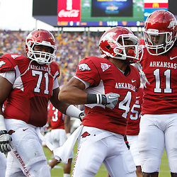 November 25, 2011; Baton Rouge, LA, USA;  Arkansas Razorbacks wide receiver Jarius Wright (4) celebrates after scoring a touchdown during the second quarter of a game against the LSU Tigers at Tiger Stadium.  Mandatory Credit: Derick E. Hingle-US PRESSWIRE