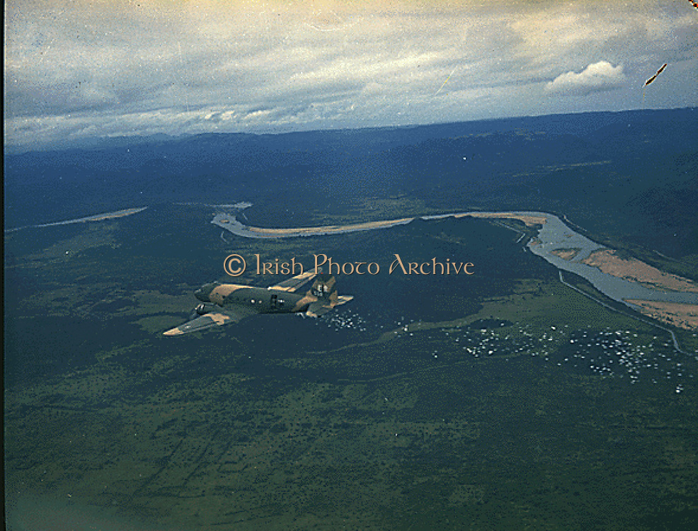 A US Air Force C-47 airplane releasing psychological warfare leaflets near Nha Trang, South Vietnam. August 1969 NARA photograph.