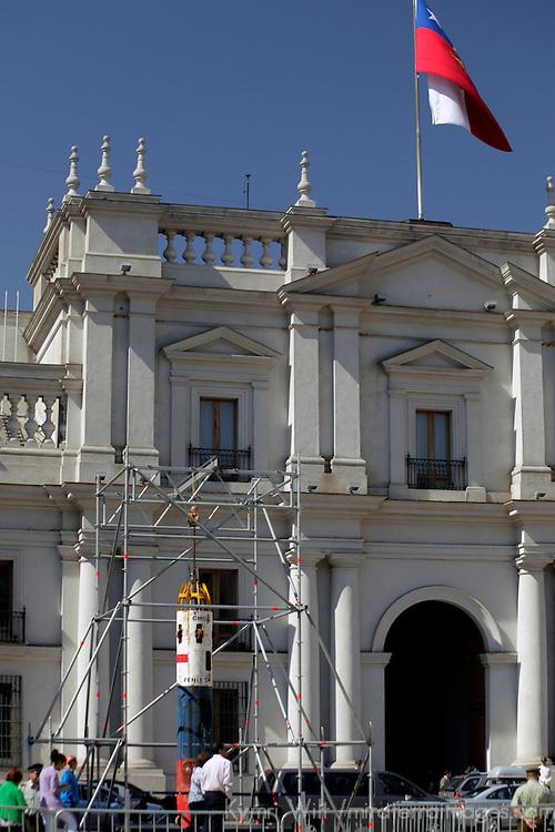 South America, Chile, Santiago. Chilean Miner's Rescue Pod in front of Palacio de La Moneda.