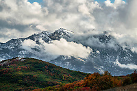 Stormy skies over Weber Canyon as the Fall colors along Trappers Loop Road show brilliantly after an afternoon snowstorm.