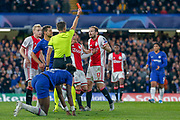 RED CARD referee Erik Ten Hag gives Ajax defender Daley Blind (17) a red card during the Champions League match between Chelsea and Ajax at Stamford Bridge, London, England on 5 November 2019.