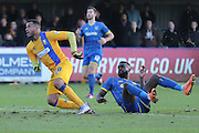Matt Green of Mansfield Town escapes Karleigh Osborne of AFC Wimbledon tackle during the Sky Bet League 2 match between AFC Wimbledon and Mansfield Town at the Cherry Red Records Stadium, Kingston, England on 16 January 2016. Photo by Stuart Butcher.