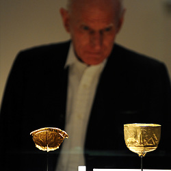©London News pictures. 01.03..2011. A man looks at a gold drinking goblets. A press view of Afghanistan: Crossroads of the Ancient World and Exhibition of treasures from the National Museum of Afghanistan on show at the British Museum today (Tuesday 1st March 2011). Picture Credit should read Stephen Simpson/LNP