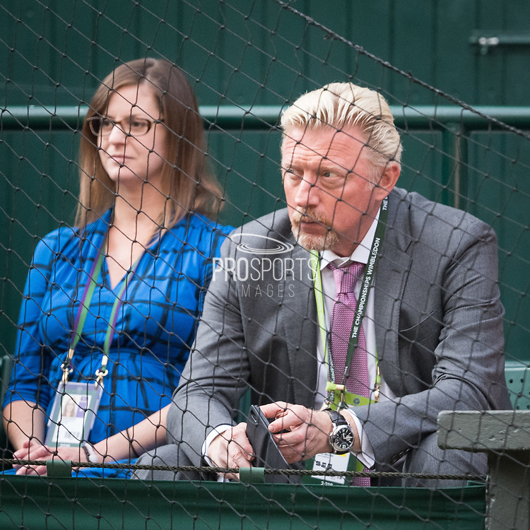 13 July 2018.  The Wimbledon Tennis Championships 2018 held at The All England Lawn Tennis and Croquet Club, London, England, UK.  <br /> <br /> Kevin Anderson RSA) [8] vs John Isner (USA) [9] on Centre Court.  Pictured:- Boris Becker watches to match.