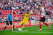 Luke O'Neill (#2) of AFC Wimbledon looks to cross the ball as Chris Maguire (#7) of Sunderland AFC appeals to the assistant referee during the EFL Sky Bet League 1 match between Sunderland and AFC Wimbledon at the Stadium Of Light, Sunderland, England on 24 August 2019.