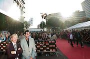 Bekende en minder bekende Nederlanders lopen over de rode loper bij de première van de musical We Will Rock You. De bandleden van Queen waren via een andere ingang naar binnen gegaan.<br /> <br /> Cornald Maas (right) and his friend are posing for photographers at the premiere of the musical We Will Rock You in Utrecht.