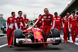 Ferrari SF16-H pushed to scrutineering.<br /> 27.10.2016. Formula 1 World Championship, Rd 19, Mexican Grand Prix, Mexico City, Mexico, Preparation Day.<br />  <br /> / 271016 / action press