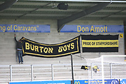 A solitary Burton Albion fan puts up the supporters banners during the EFL Sky Bet Championship match between Burton Albion and Ipswich Town at the Pirelli Stadium, Burton upon Trent, England on 28 October 2017. Photo by John Potts.