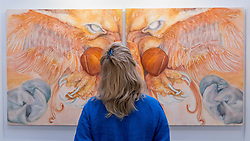 © Licensed to London News Pictures. 06/10/2016. London, UK. A visitor views a work by artist Gordon Glyn-Jones, at the preview of Moniker Art Fair, part of London Art Week, taking place at the Old Truman Brewery, near Brick Lane.  Now in its seventh year, the fair embraces contemporary art from emerging and established artists, the majority of whom attend the fair in person in order to meet potential collectors and to show their work. Photo credit : Stephen Chung/LNP