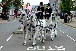 © Licensed to London News Pictures 26/09/2013. Machynlleth. Wales. The family of April Jones has said a final farewell to the murdered schoolgirl as the mid-Wales town that shared their grief came to a standstill. A white horse-drawn hearse led mourners, including the five-year-old's parents Paul and Coral and their two children from their Machynlleth home to St Peter's Church. Crowds lined the streets and filled the church and its graveyard for the long-awaited service. April's family held the funeral one year after she was killed by Mark Bridger. Photographer Andrew Chittock/LNP