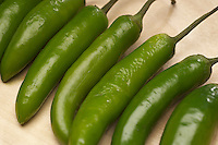 Green chili peppers in row, close-up