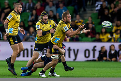 March 30, 2018 - Melbourne, VIC, U.S. - MELBOURNE, AUSTRALIA - MARCH 30 : Brad Shields of the Wellington Hurricanes  passes off the ball while being tackled during Round 7 of the Super Rugby Series between the Melbourne Rebels and the Wellington Hurricanes on March 30, 2018, at AAMI Park in Melbourne, Australia. (Photo by Jason Heidrich/Icon Sportswire) (Credit Image: © Jason Heidrich/Icon SMI via ZUMA Press)