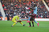 Football - 2019 / 2020 Premier League - AFC Bournemouth vs. Aston Villa<br /> <br /> Bournemouth's Aaron Ramsdale collects the ball from Bournemouth's Nathan Ake and Keinan Davis of Aston Villa during the Premier League match at the Vitality Stadium (Dean Court) Bournemouth  <br /> <br /> COLORSPORT/SHAUN BOGGUST