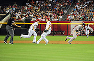 June 14 2011; Phoenix, AZ, USA; San Francisco Giants base runner Brandon Crawford (35) is chased down by second basemen Stephen Drew (6) during the fifth inning against the Arizona Diamondbacks at Chase Field. Mandatory Credit: Jennifer Stewart-US PRESSWIRE..
