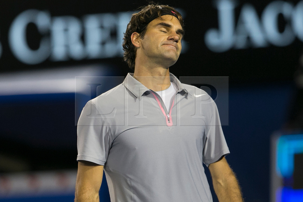 © Licensed to London News Pictures. 25/01/2013. Melbourne Park, Australia. A dissapointed Roger Federer closes his eyes in dissappointment during the Mens Semi Final between Andy Murray Vs Roger Federer of the Australian Open. Photo credit : Asanka Brendon Ratnayake/LNP