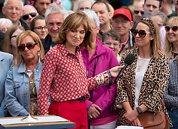 Dundee, Scotland, UK. 23 June 2019. The BBC Antiques Roadshow TV programme is aiming on location t the new V&A Museum in Dundee today. Long queues formed as members of the public arrived with their collectables to have them appraised and valued by the Antiques Roadshow experts. Select items and their owners were chosen to be filmed for the show. Pictured Fiona Bruce presenting Bigger, Better, Best item of the show.