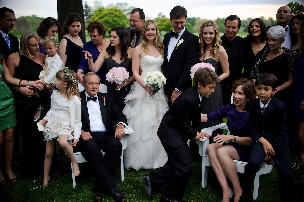 photo by Matt Roth.Saturday, April 14, 2012.Assignment ID: 30124225A..Newlyweds Molly Spencer Palmer and Lee Cowan stand front and center while family members are being arranged for the family wedding portrait during the reception at the Chevy Chase Club in Washington D.C. Saturday, April 14, 2012...Molly Palmer, 29, and Lee Cowan, 46, were colleagues at NBC News, but it wasn't until The Balloon Boy story coverage in 2009 that their romance sparked.