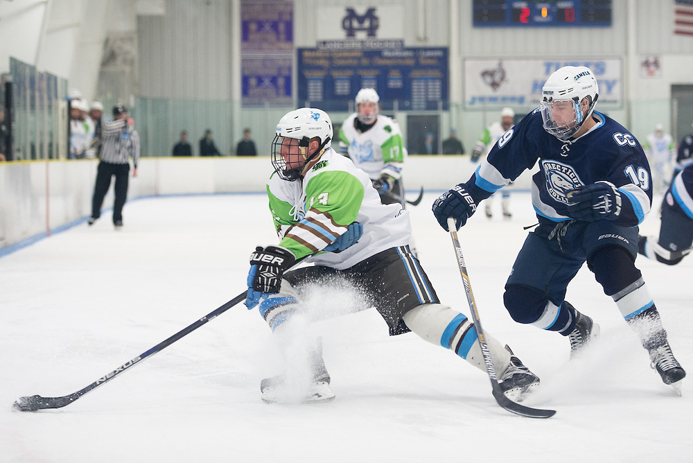 2/5/16 – Medford/Somerville, MA – Fighting a Hamilton defenseman, Tufts forward Matt Pugh, A17, rapidly changes direction with the puck in the game against Conn. College on Friday, Feb. 5, 2016. (Evan Sayles / The Tufts Daily)