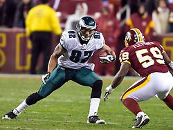 Philadelphia Eagles tight end L.J. Smith (82) takes on Washington Redskins linebacker London Fletcher (59) in the open field on the game's final drive.  The Washington Redskins defeated the Philadelphia Eagles 10-3 in an NFL football game held at Fedex Field in Landover, Maryland on Sunday, December 21, 2008.