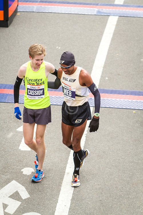 ING New York CIty Marathon: Michael Cassidy and Meb Keflezighi walk off course after they finish race together