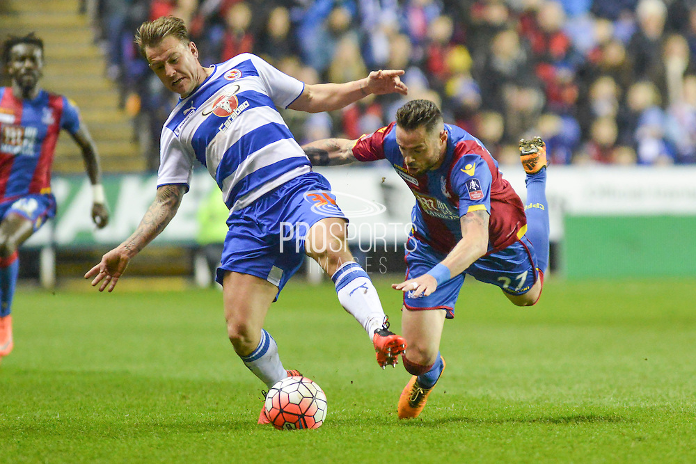 Reading FC striker Simon Cox battles with Crystal Palace defender Damien Delany during the The FA Cup Quarter Final match between Reading and Crystal Palace at the Madejski Stadium, Reading, England on 11 March 2016. Photo by Mark Davies.