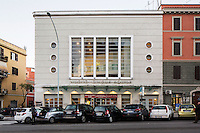 ROME, ITALY - 6 January 2014: The Nuovo Cinema Aquila movie theatre, where a recent renovation turned the devades old theatre into a glossy box of glass and steel, in the Pigneto turned the decade neighborhood of Rome, Italy, on February 6th 2014.