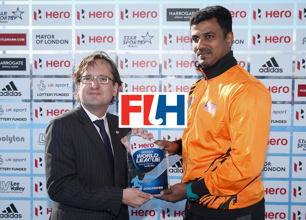 LONDON, ENGLAND - JUNE 25:  Kumar Subramiam of Malaysia is presented with his Best Goalkeeper award after the final match between Argentina and the Netherlands on day nine of the Hero Hockey World League Semi-Final at Lee Valley Hockey and Tennis Centre on June 25, 2017 in London, England.  (Photo by Alex Morton/Getty Images)