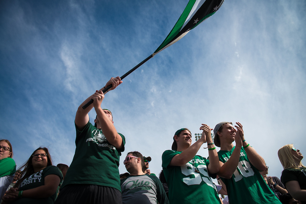 Daniel Bonner waves an Ohio flag after a Ohio University first down during the Bobcat's homecoming matchup against Bowling Green in Athens, Ohio on Saturday, October 8, 2016.