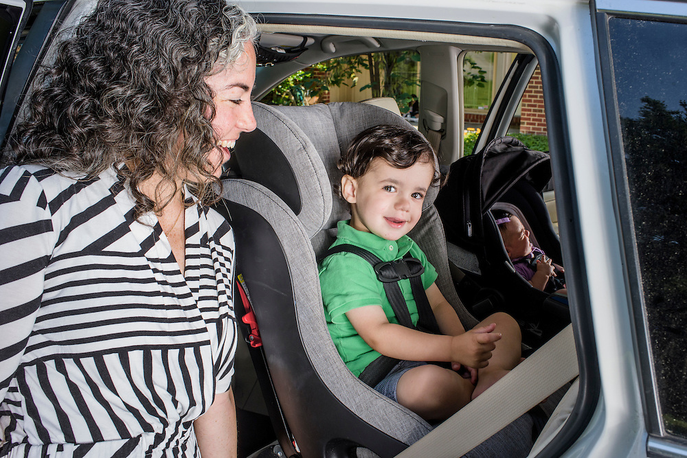 Pikesville, Maryland - June 25, 2015:  Car Seat Lady Alisa Baer, 35, from Manhattan, demonstrates the preferred way to seat children in a car, back-facing. <br /> <br /> Her seven-week old niece, Leora Aghion, sits in a Nuna Pipa infant seat ($300), and her nephew, Eitan Aghion, 2, sits in a Clek Foonf ($400-$550), outside Alisa's sister Abigail Aghion's house in Pikesville, Maryland. <br /> <br /> <br /> Alisa Baer, 35, and Emily Levine, 34, both from Manhattan and Alisa's mother Deborah Baer, 67, from Pikesville, Maryland operate The Car Seat Lady blog and car seat installation classes available in New York and Maryland. <br /> <br /> CREDIT: Matt Roth for The New York Times<br /> Assignment ID: 30176354A