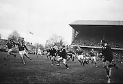 New Zealand forward S T Meads, in possession, runs for the Irish line, with Ronnie Dawson of Ireland on right,..Irish Rugby Football Union, Ireland v New Zealand, Tour Match, Landsdowne Road, Dublin, Ireland, Saturday 7th December, 1963,.7.12.1963, 12.7.1963,..Referee- H Keenen, Rugby Football Union, ..Score- Ireland 5 - 6 New Zealand, ..Irish Team, ..T J Kiernan, Wearing number 15 Irish jersey, Full Back, Cork Constitution Rugby Football Club, Cork, Ireland,..J Fortune, Wearing number 14 Irish jersey, Right Wing, Clontarf Rugby Football Club, Dublin, Ireland,..P J Casey, Wearing number 13 Irish jersey, Right Centre, University College Dublin Rugby Football Club, Dublin, Ireland, ..J C Walsh,  Wearing number 12 Irish jersey, Left Centre, University college Cork Football Club, Cork, Ireland,..A T A Duggan, Wearing number 11 Irish jersey, Left Wing, Landsdowne Rugby Football Club, Dublin, Ireland,..M A English, Wearing number 10 Irish jersey, Stand Off, Landsdowne Rugby Football Club, Dublin, Ireland, ..J C Kelly, Wearing number 9 Irish jersey, Captain of the Irish team, Scrum Half, University College Dublin Rugby Football Club, Dublin, Ireland,..P J Dwyer, Wearing number 1 Irish jersey, Forward, University College Dublin Rugby Football Club, Dublin, Ireland, ..A R Dawson, Wearing number 2 Irish jersey, Forward, Wanderers Rugby Football Club, Dublin, Ireland, ..R J McLoughlin, Wearing number 3 Irish jersey, Forward, Gosforth Rugby Football Club, Newcastle, England, ..W J McBride, Wearing number 4 Irish jersey, Forward, Ballymena Rugby Football Club, Antrim, Northern Ireland,..W A Mulcahy, Wearing number 5 Irish jersey, Forward, Bective Rangers Rugby Football Club, Dublin, Ireland,  ..E P McGuire, Wearing number 6 Irish jersey, Forward, University college Galway Football Club, Galway, Ireland,  ..P J A O' Sullivan, Wearing  Number 8 Irish jersey, Forward, Galwegians Rugby Football Club, Galway, Ireland,..N A Murphy, Wearing number 7 Irish jersey, Forward, Cork Constitu