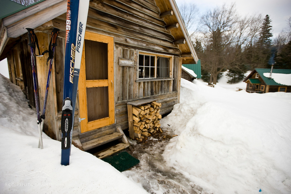 Skis outside a cabin at Little Lyford Pond Camps near Greenville, Maine.  Winter.
