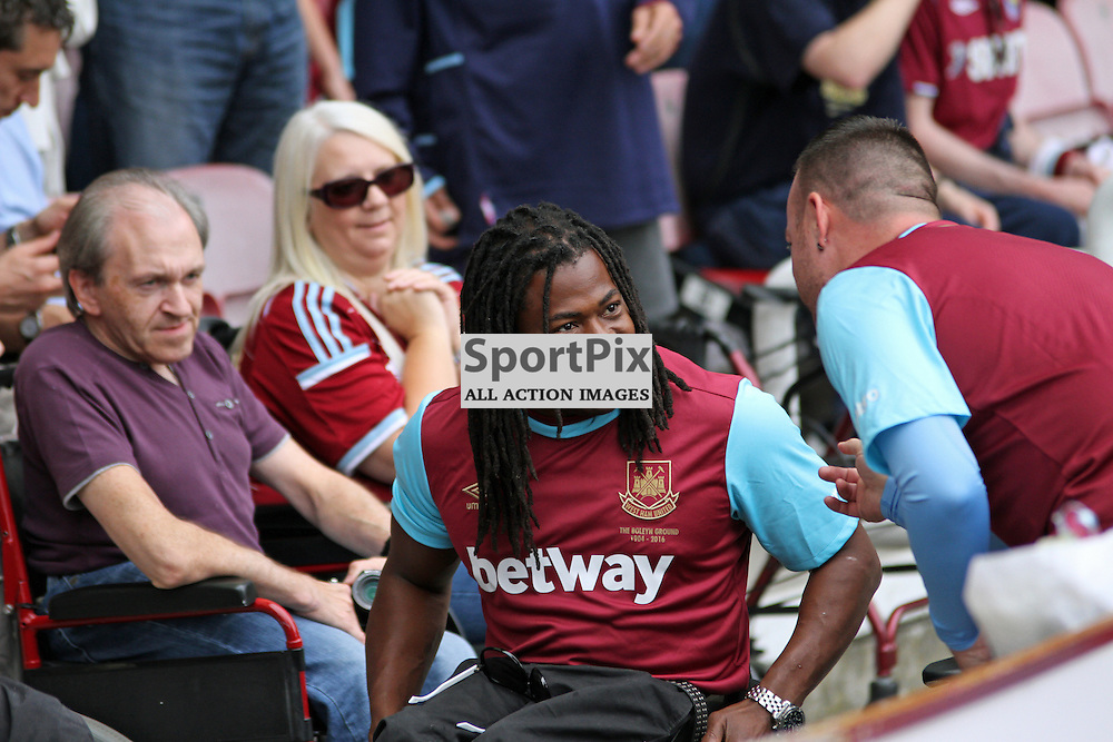 Great British Paralympic athlete Ade Adepitan in the crowd During West Ham United vs Leicester City on Saturday the 16th August 2015.
