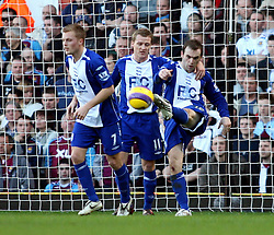 s James McFadden (right) celebrates his goal from the penalty spot against West Ham Unite during the Premiership match at Upton Park. (Photo by Chris Ratcliffe/Propaganda)