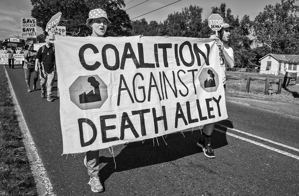 Members of the Concerned Citiznes of St. John and the Coalition Agianst Death Alley on march from the 5th Ward Elementry Scholl to  the Denka Plant on the fourth day of a march through Cancer Alley.