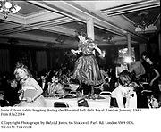 Susie Calvert table-hopping during the Bluebird Ball. Cafe Royal. London January 1983. Film 83a22f34<br />