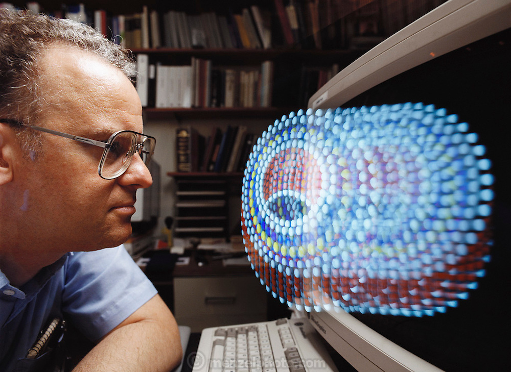 Nano Technology: Molecular bearing. Computer scientist Ralph Merkle models a molecular bearing designed on computer. Merkle is head of Computational Nanotechnology at Xerox Parc (Palo Alto Research Center) in California, USA. Using desktop simulations he builds tiny machines atom by atom, such as this frictionless bearing, which would be too small to see even with the world's most powerful microscope. Although still on the frontiers of science, nanotechnology could one day lead to a host of revolutionary miniature inventions, such as microscopic nanorobots that patrol the human body in search of cancer tumors. Model Released [1995]