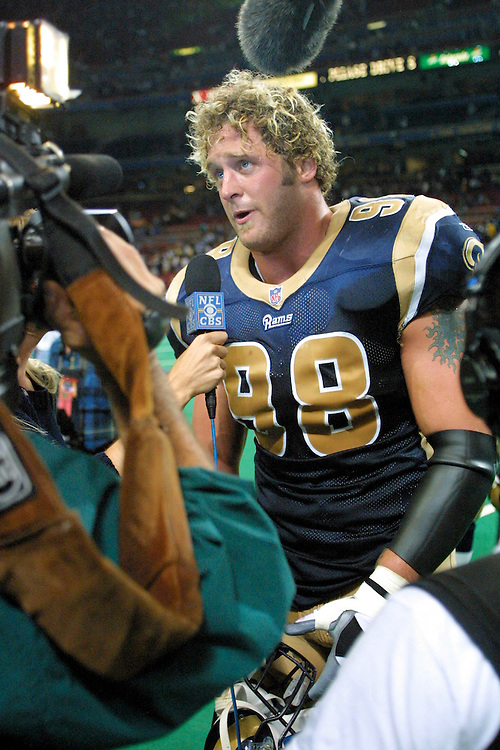 St. Louis Rams Defensive end Grant Wistrom (98) gets interviewed about his interception after a 15 to 14 win over the New York Giants on 10/14/2001..©Wesley Hitt/NFL Photos