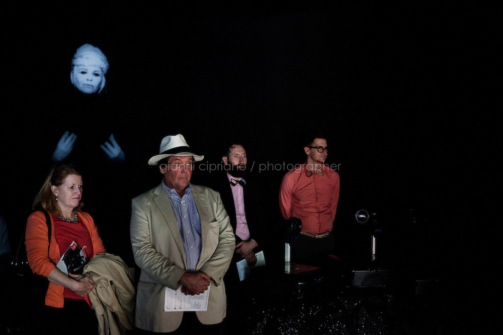 VENICE, ITALY - 29 MAY 2013: Visitors watch the projection of &quot;The Cave Painter&quot; as &quot;Silent Dedication&quot; is projected in the back, at the Pavillon of Canada, Giardini of the Biennale,  in Venice, Italy, on May 29th 20113. <br /> <br /> With &quot;Music for Silence&quot; the Toronto-based artist Shary Boyle explores ideas of silence, isolation and solutude. &quot;Music for Silence&quot; is a totale re-imagining of Canada's national space, merging imagination and folklore with humanistic, feminist and social concerns. &quot;Music for Silence&quot; showcases the exceptional level of hand-made craft signature to Boyle's practice, in which she works in a range of media including sculpture, drawing, painting and performance. She states: &quot;In conceiving this installation, I thought a lot about the emotional entitlement we afford ourselves when we are moved by a song. I considered experiencing art as on would music; with trust in perception and intelligence of feeling. Each object is a note; building an arc and repeating; suggesting cycles and rythms.<br /> <br /> The 55th International Art Exhibition of the Venice Biennale takes place in Venice from June 1st to November 24th, 2013 at the Giardini and at the Arsenale as well as in various venues the city. <br /> <br /> Gianni Cipriano for The New York TImes