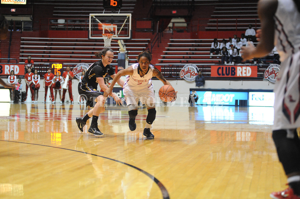 """Ole Miss Lady Rebels guard A'Queen Hayes (3) vs. Southern Mississippi Lady Golden Eagles guard Alex Coyne (00) at the C.M. """"Tad"""" Smith Coliseum in Oxford, Miss. on Thursday, December 18, 2014. (AP Photo/Oxford Eagle, Bruce Newman)"""