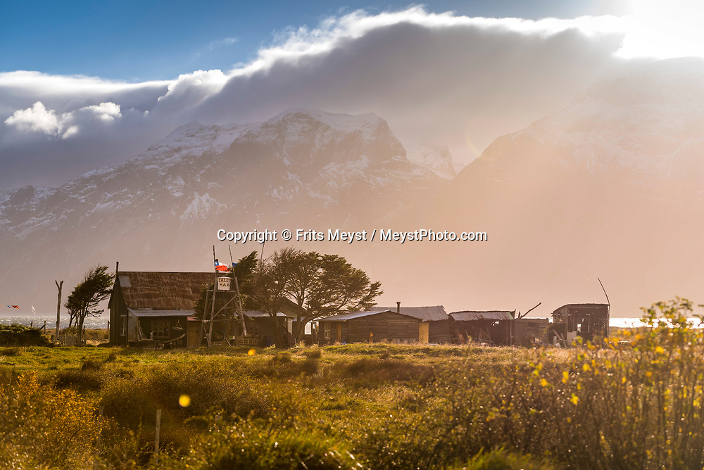 Porvenir, Tierra del Fuego, Chile, June 2017. Estancia Caleta Maria marks the end of the southernmist road in Chile. The windswept pampas of Southern Patagonia and Tierra del Fuego are truly among the one of the world's last frontiers. It was settled by European sheep farmers who have been carving out an existence in this barren land since the 19th century. In a race to control access to 'the end of the world' the Chilean government built a spectacular road, which now functions as the access to some of the last unexplored wildernesses on earth. Welcome to the Darwin Range, Karukinka National Park. Hiking, horseback riding and fly fishing awaits those who are ready for Adventure. Photo by Frits Meyst / MeystPhoto.com