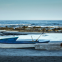 Fishing boats in the early morning on Guiones Beach, Costa Rica.
